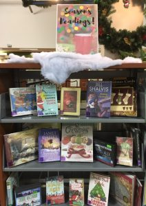 Season's Reading holiday book display at the library for December